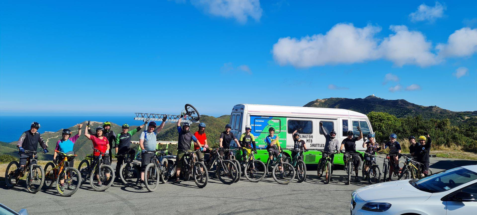 Group of cyclists infront of shuttle